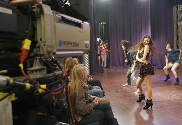 "Actress Victoria Justice(2nd from right) and the cast in the taping of a high school performance scene for the show ""Victorious"" at Nickelodeon's studio in Hollywood."