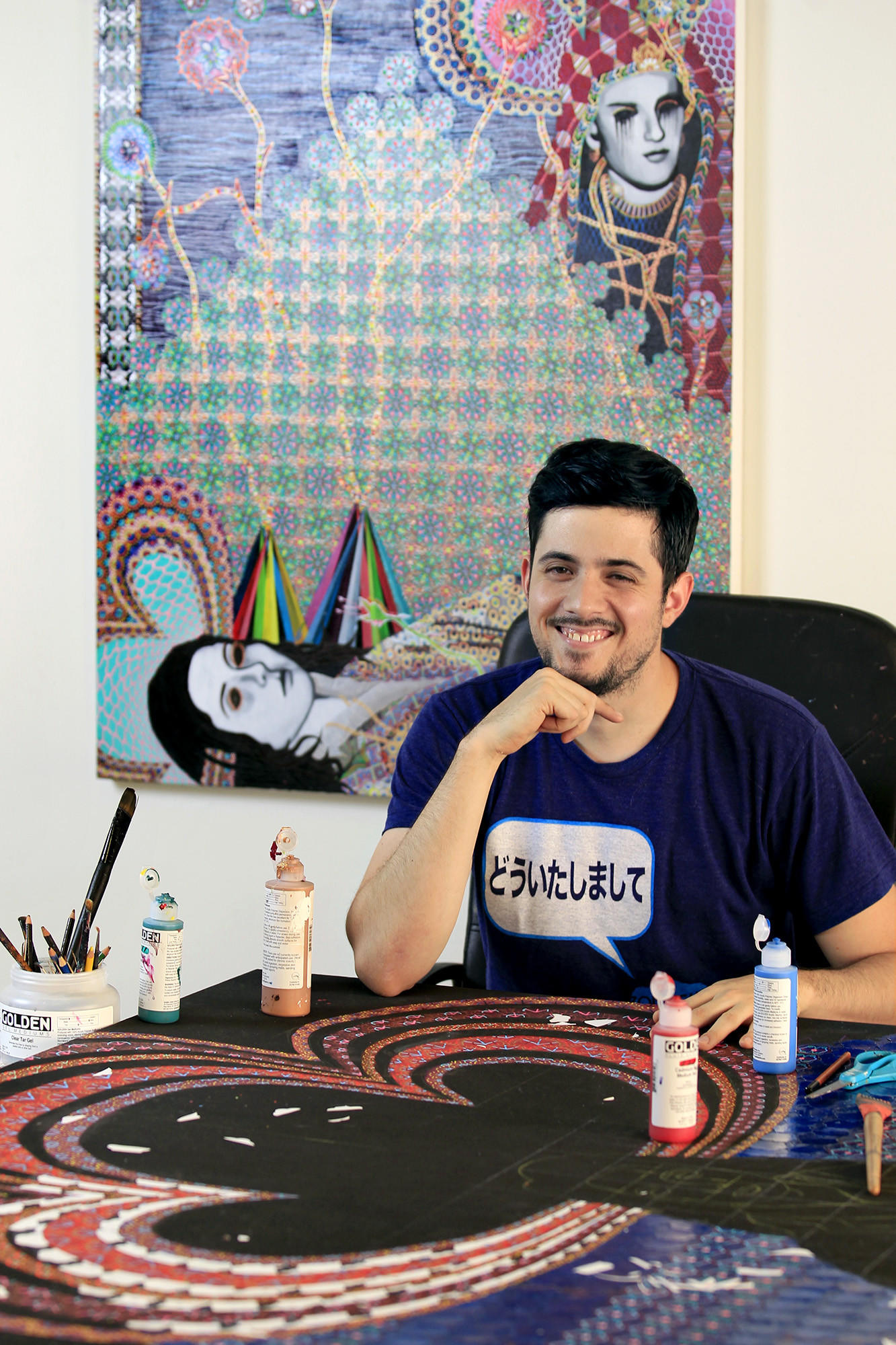 Artist Asad Faulwell, 31, poses for a photo at his home studio in Newport Beach. The Orange County Museum of Art will host Art Auction 2014, with more than 60 museum-quality works of art that will be auctioned off on March 14. Proceeds benefit the museum's exhibition and education programs.