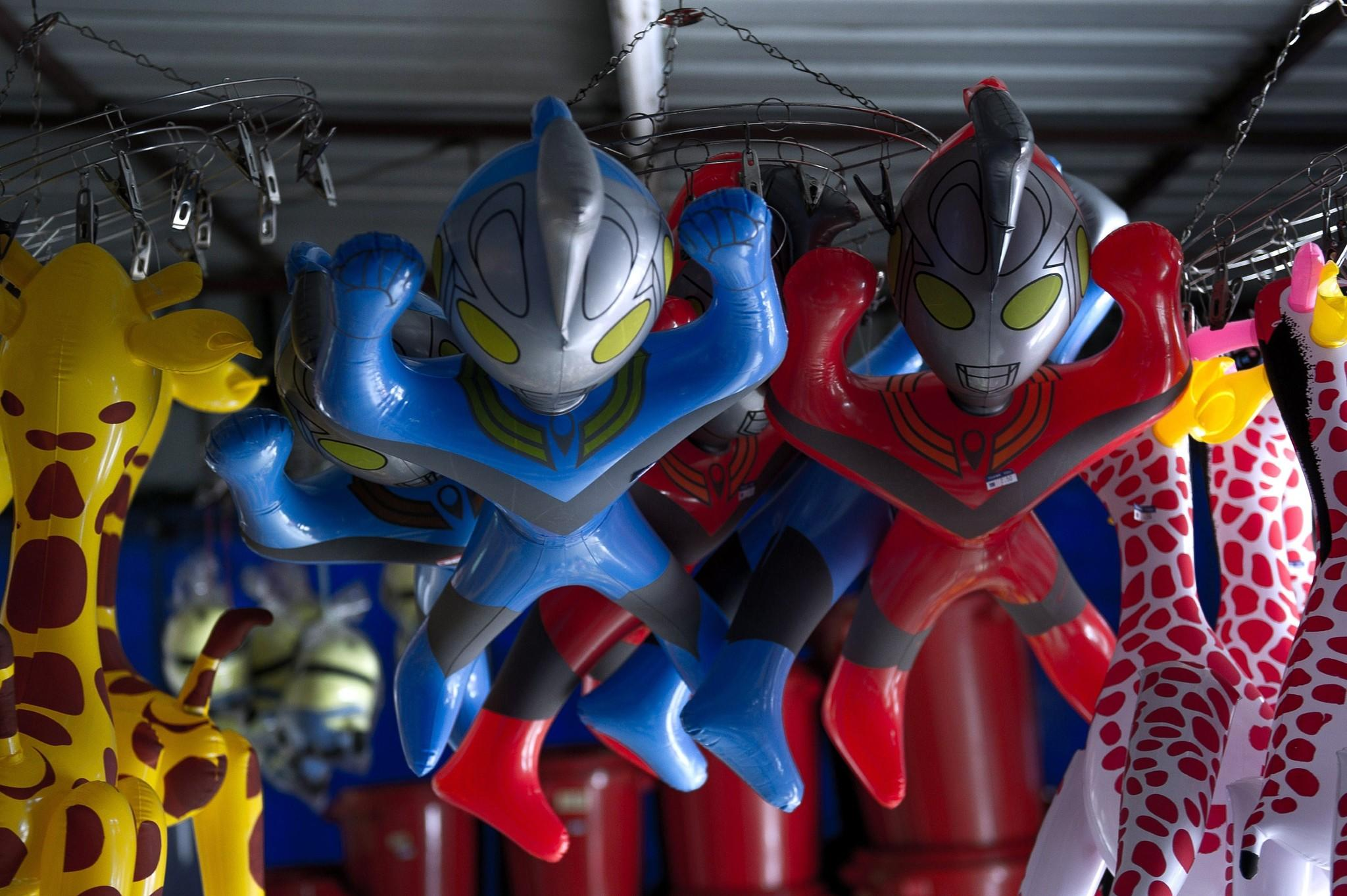 "Plastic toys of Japanese animation superhero ""Ultraman"" hang from the ceiling of a shop for sale in Karak, east of Kuala Lumpur on March 7, 2014. Malaysia has banned a translation of an Ultraman comic book after it referred to the popular Japanese superhero as ""Allah"", authorities said on March 7 during an ongoing row over use of the word by non-Muslims. Ultraman first appeared on television in the 1960s and the comic gained popularity worldwide, including in Malaysia, where versions dubbed in Malay were screened on TV and comic books translated into the national language."