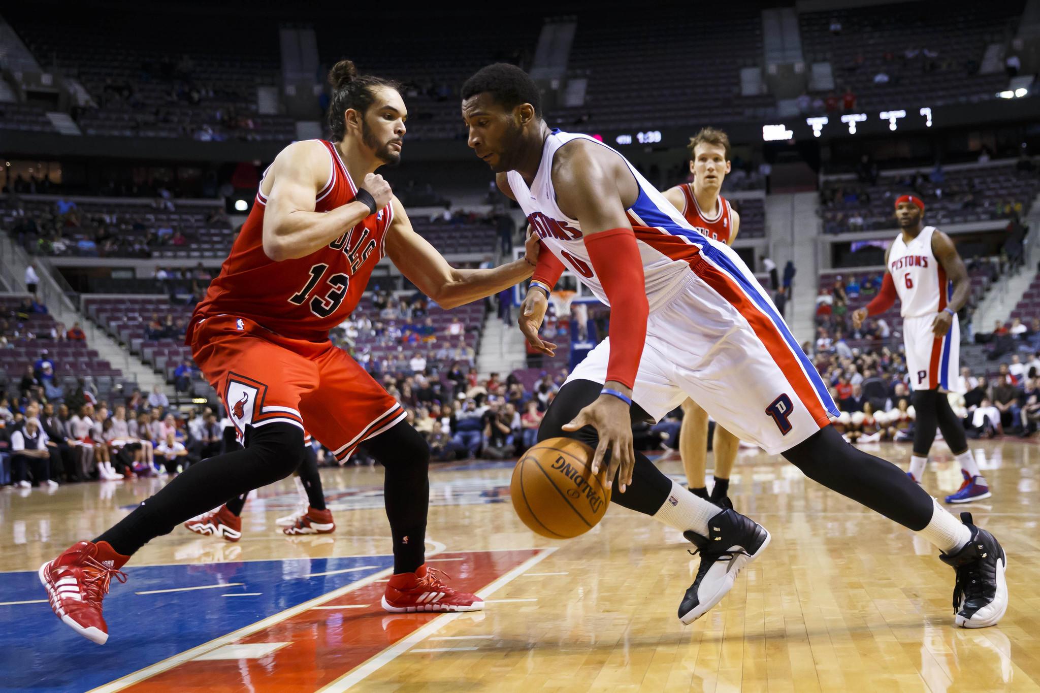 Detroit Pistons center Andre Drummond dribbles at Chicago Bulls center Joakim Noah.