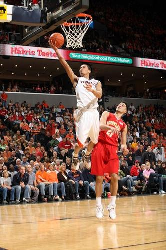 Virginia's Mustapha Farrakahn (2) shoots in front of Maryland's Greivis Vasquez during a NCAA college basketball game Saturday March 6, 2010 in Charlottesville, Va.