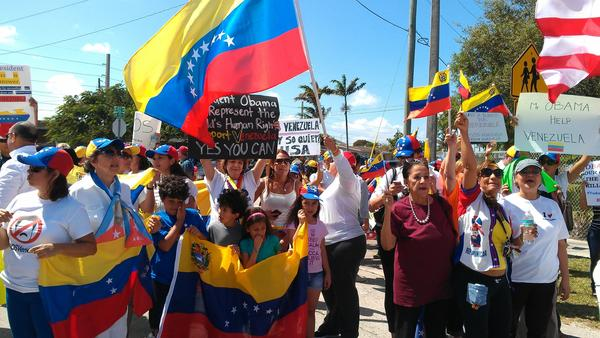Members of the Venezuelan community outside Coral Reef High School in Southwest Miami-Dade County on hand for President Barack Obama's arrival. (Photo by Anthony Man)