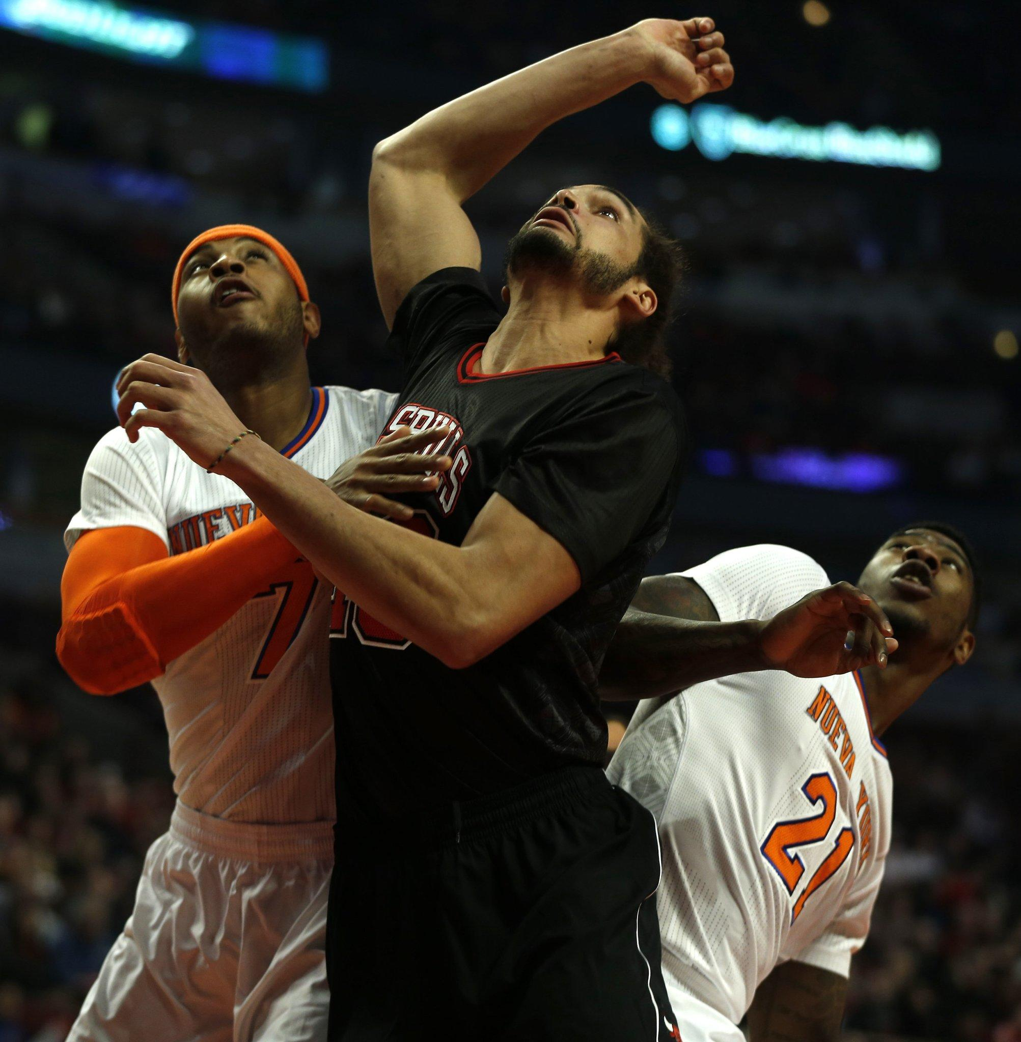 Chicago Bulls' Joakim Noah (right) vies for rebound position against New York Knicks' Carmelo Anthony on March 2.