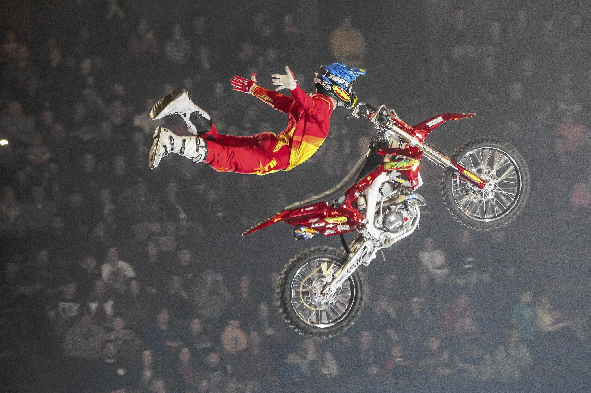 "A member of the ""Nuclear Cowboyz"" takes flight in one of the show's many trick jumps."
