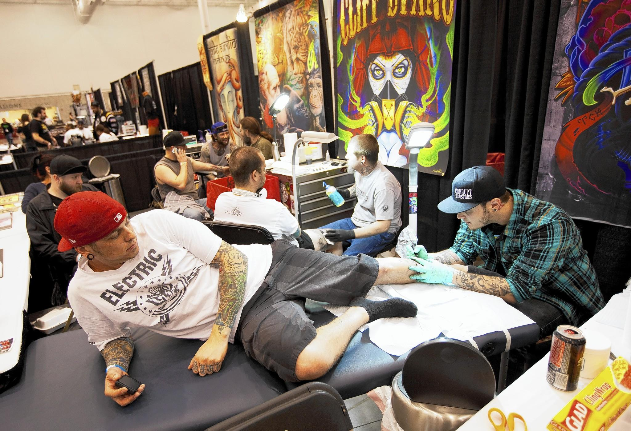 Brad Orr of Virginia Beach gets a tattoo on his leg by Drew Elish, a tattoo artist of Virginia Beach, at the 1st Hampton Roads Tattoo Arts Festival in Hampton in 2011. Over 150 tattoo artists participate in this three days festival, which draws tattoo enthusiasts.