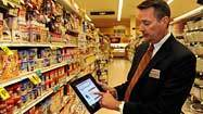 Grocery retailers compete with mobile shopping tools