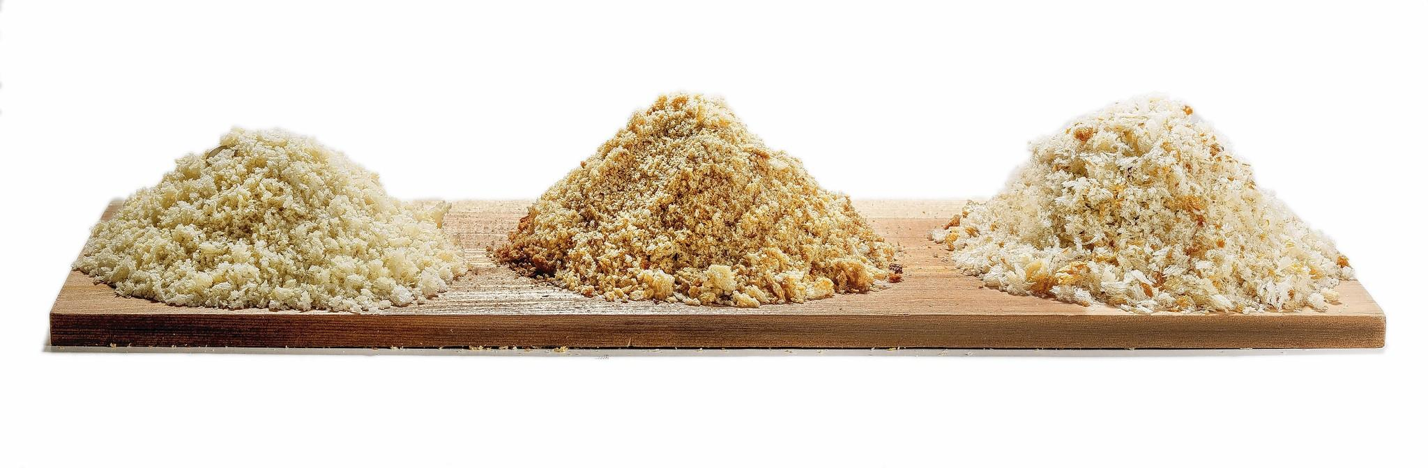 Piles of different bread crumbs.