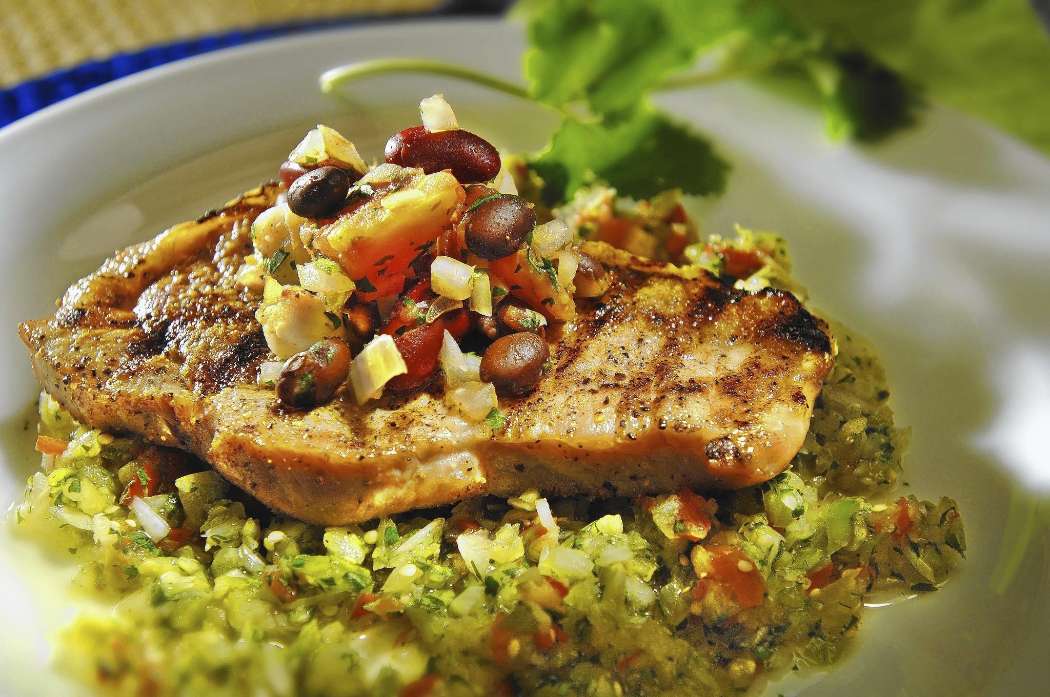 Cumin-crusted pork chops over green salsa recipe.