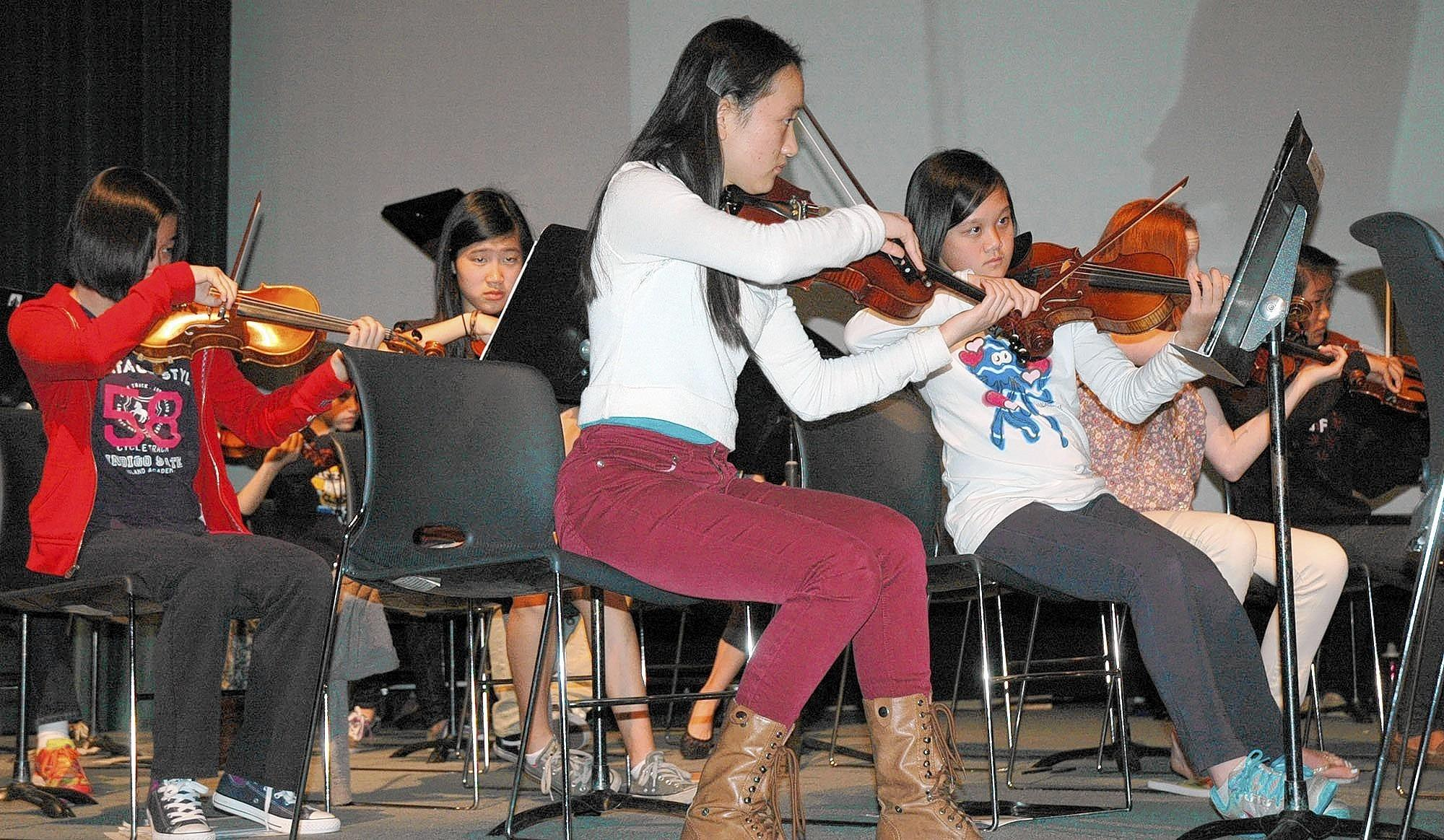 Members of the Glendale Youth Orchestra rehearse in preparation for Sunday's concert at the Alex Theatre in Glendale.