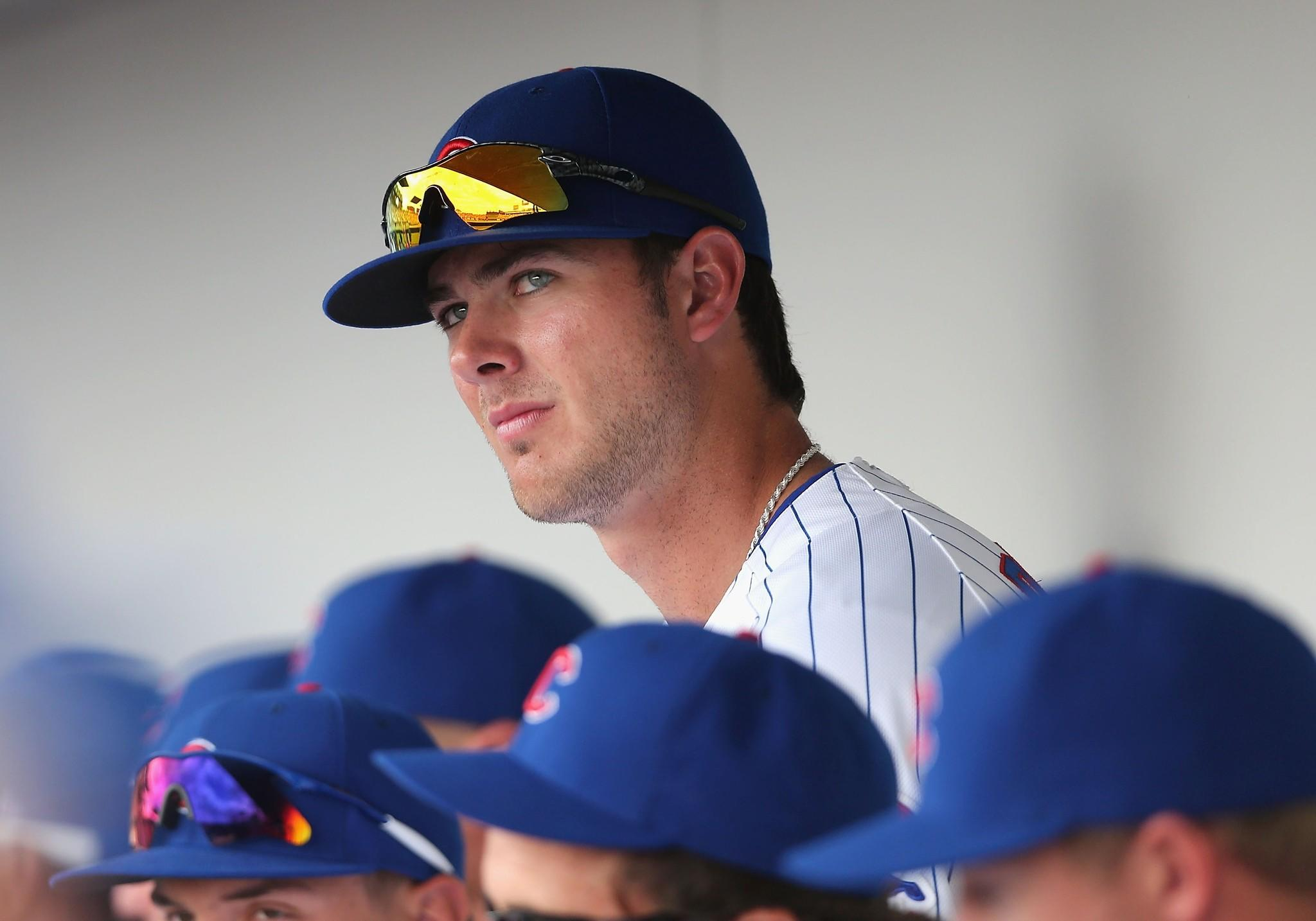 Kris Bryant of the Cubs in the dugout during a spring training game.