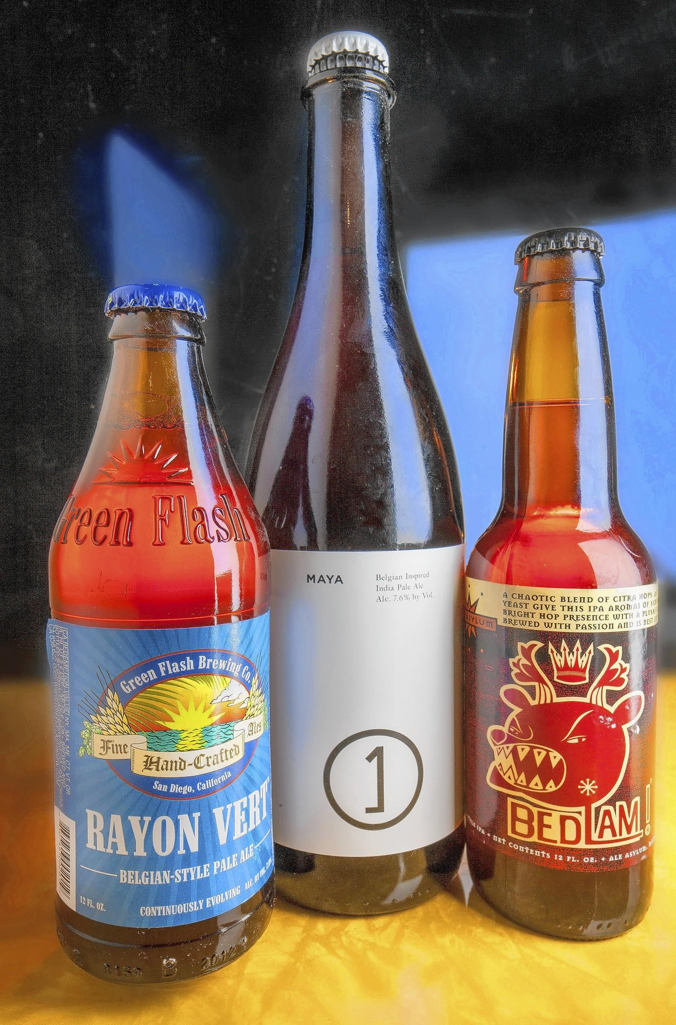 Three bottles of Belgian IPAs.