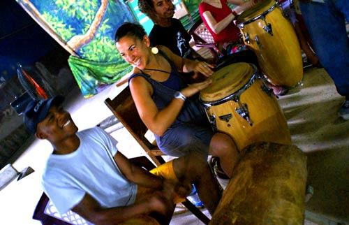 The folkloric group Cutumba gives drum lessons to participants on a Contra-Tiempo-sponsored trip to Santiago, Cuba.