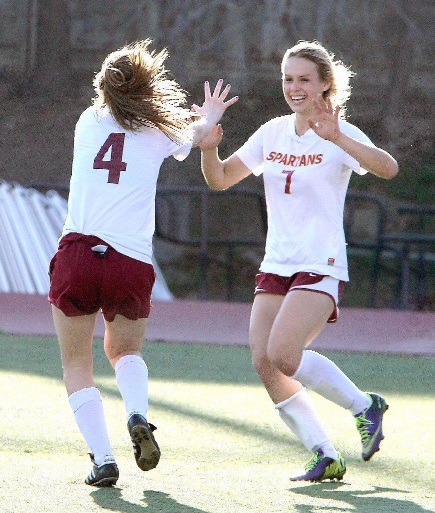 La Cañada High's Cassy Quiring (left) and Megan Decker (right) are hoping they and their teammates will celebrate one more time on Saturday morning. (Roger Wilson/File Photo)