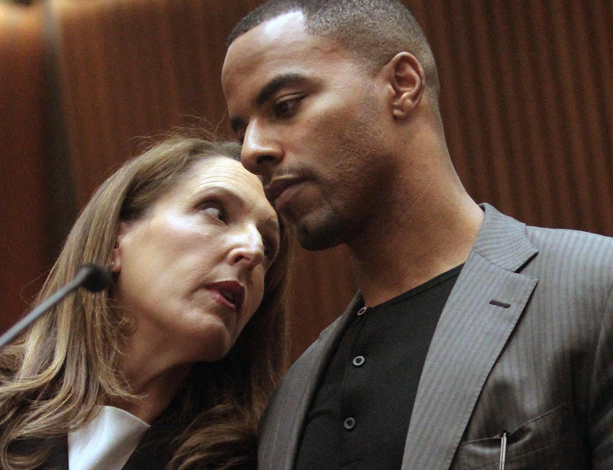 Former NFL safety Darren Sharper, right, huddles with attorney Blair Berk in Los Angeles Superior Court.
