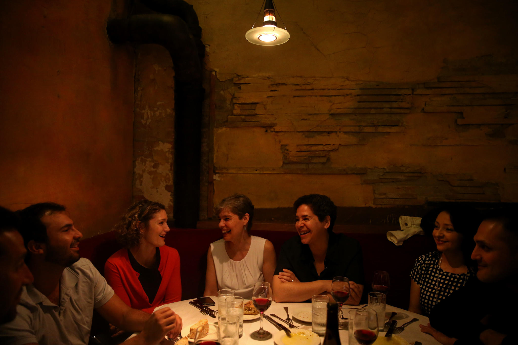 A group of friends enjoy a night out at Scoozi.