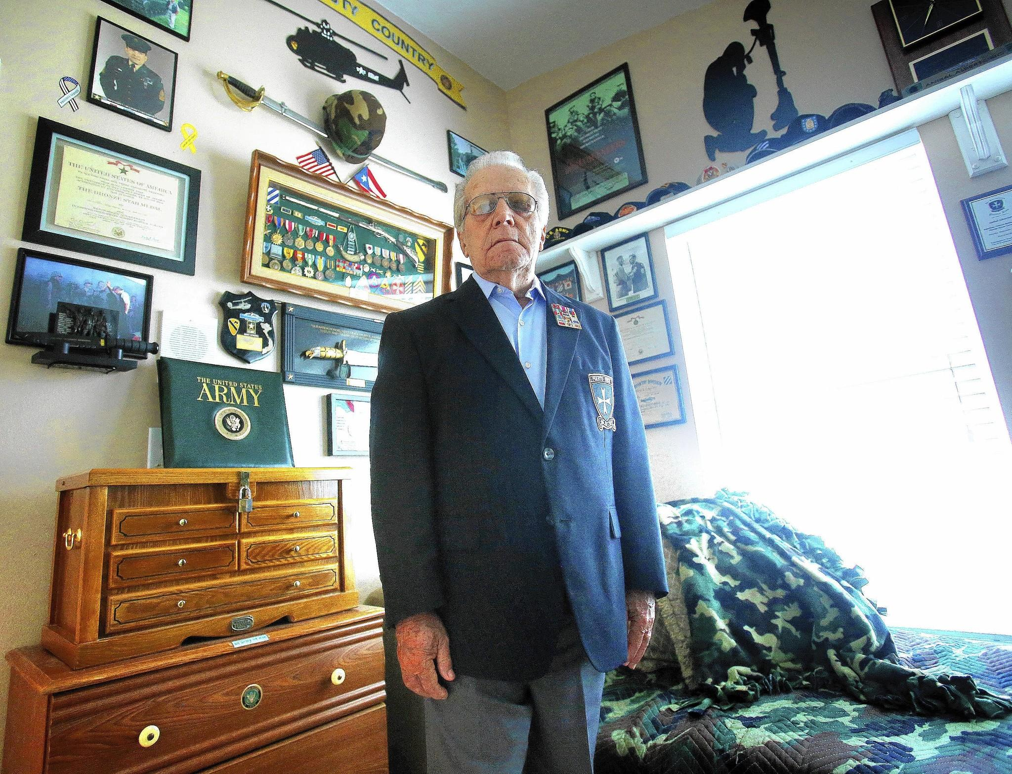 "Korean War veteran Anibal Albertorio, 84, one of the original ""Borinqueneers, Puerto Rico's famed U.S. Army troop, in his Oviedo home Thursday, Feb. 27, 2014."