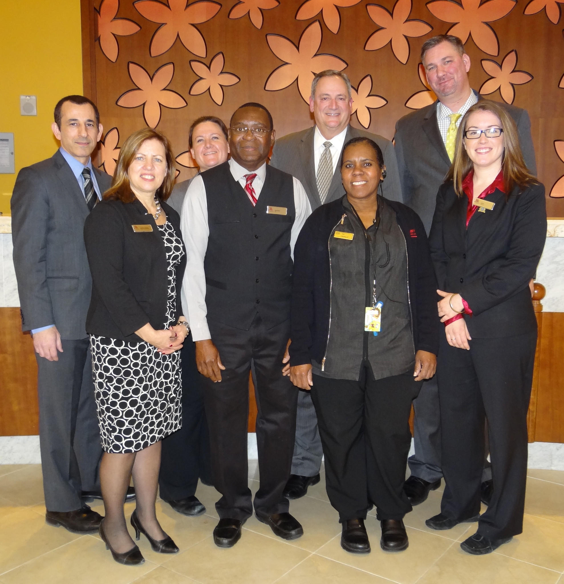 From left to right, front row: Karin Ziemba, Director of Human Resources; Musset Joseph, Room Service Server; Treslyn St. Martin, Houseperson; Erin Kennedy, Concierge Attendant. Back row left to right: Ali Dezfoli, Director of Rooms; Chelsea Doyon, Executive Housekeeper; John Fraher, General Manager; and Ron Wichowski, Director of Operations