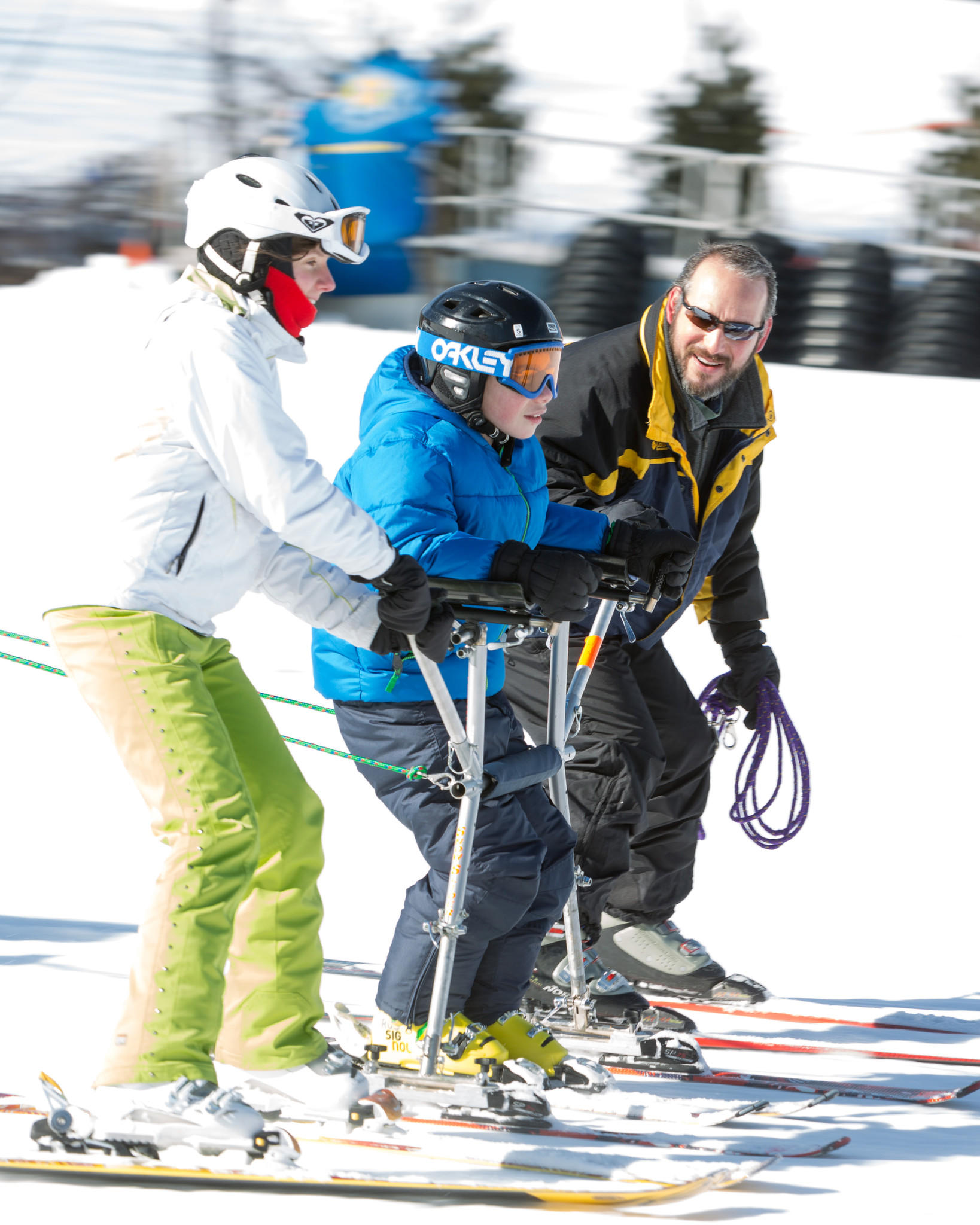 Quinnipiac University occupational therapy student Marta Parys of Oakland Gardens, N.Y. teaches Kyle Errato how to ski with the help of Kyle's father Frank at Mount Southington on Feb. 28.