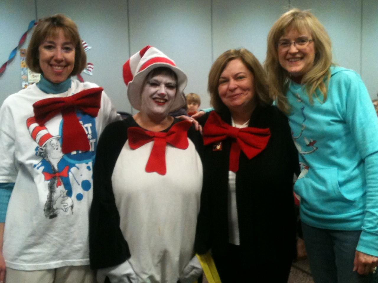 Trish Hart, the Cat in the Hat, Eva Markuszka, and Vivian Young (absent: Pat Sidlovsky).