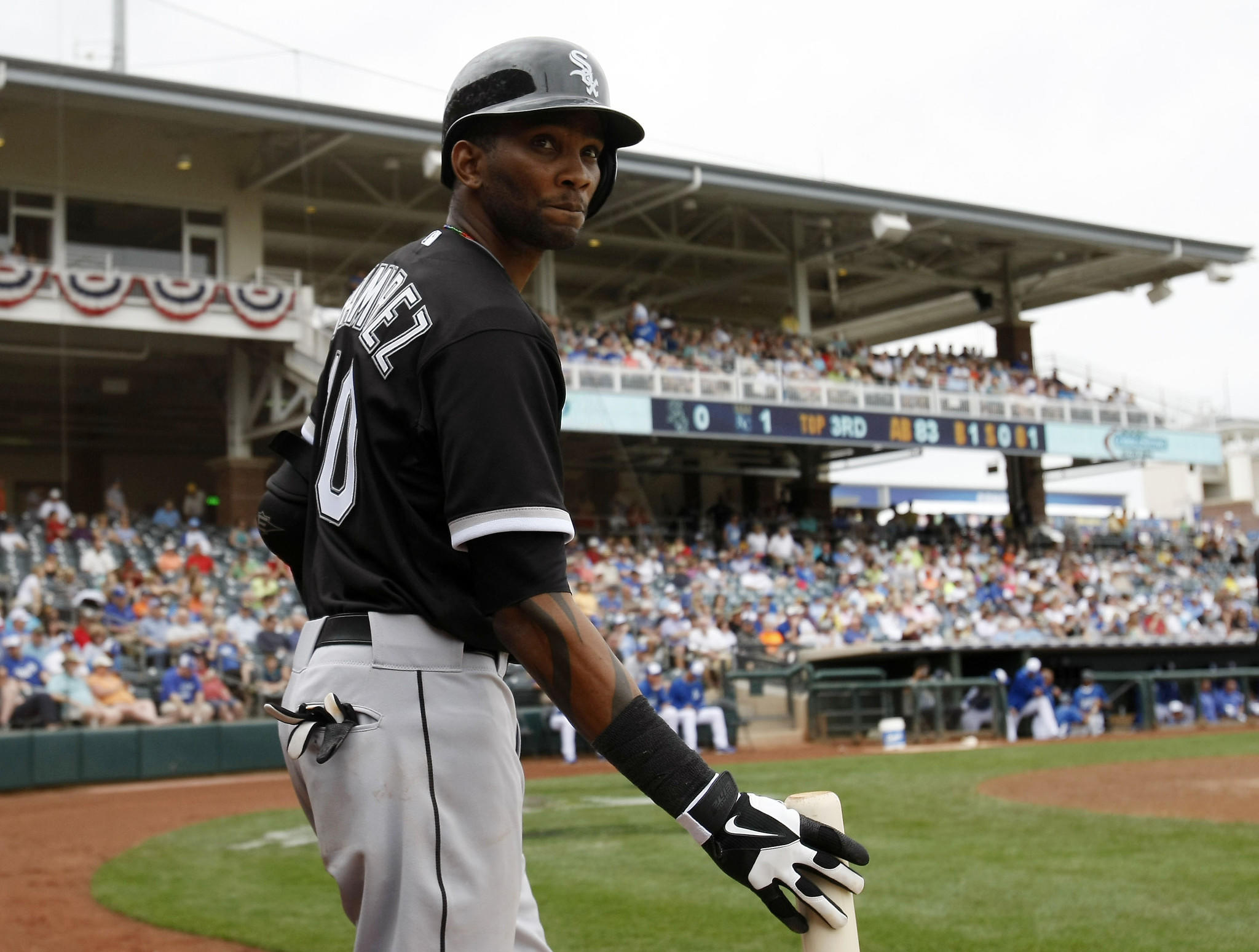 Chicago White Sox shortstop Alexei Ramirez (10) waits on deck against the Kansas City Royals in the third inning at Surprise Stadium.