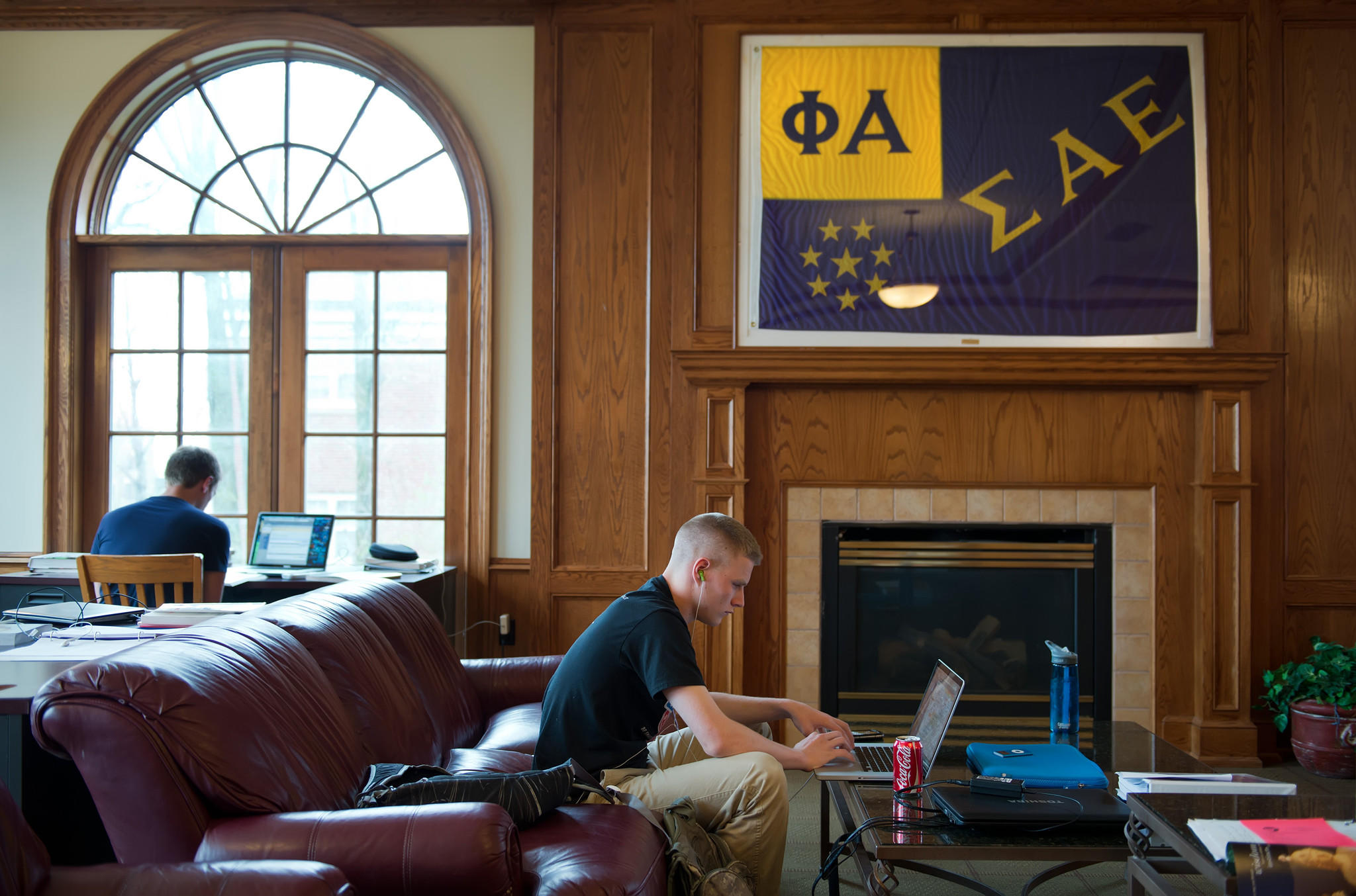 Dylan Clark, a freshman at the University of Kansas in Lawrence, studies in the library of Sigma Alpha Epsilon on campus.