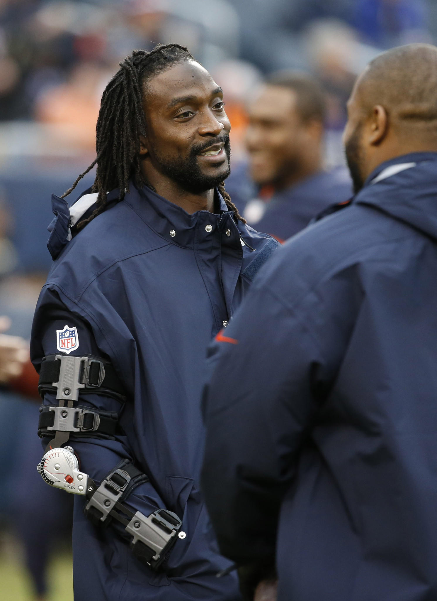 Injured Chicago Bears cornerback Charles Tillman (33) chats with injured Chicago Bears outside linebacker Lance Briggs (55) on the field during pre-game warm ups before a game against the Baltimore Ravens at Soldier Field in Chicago on Sunday, Nov. 17, 2013.