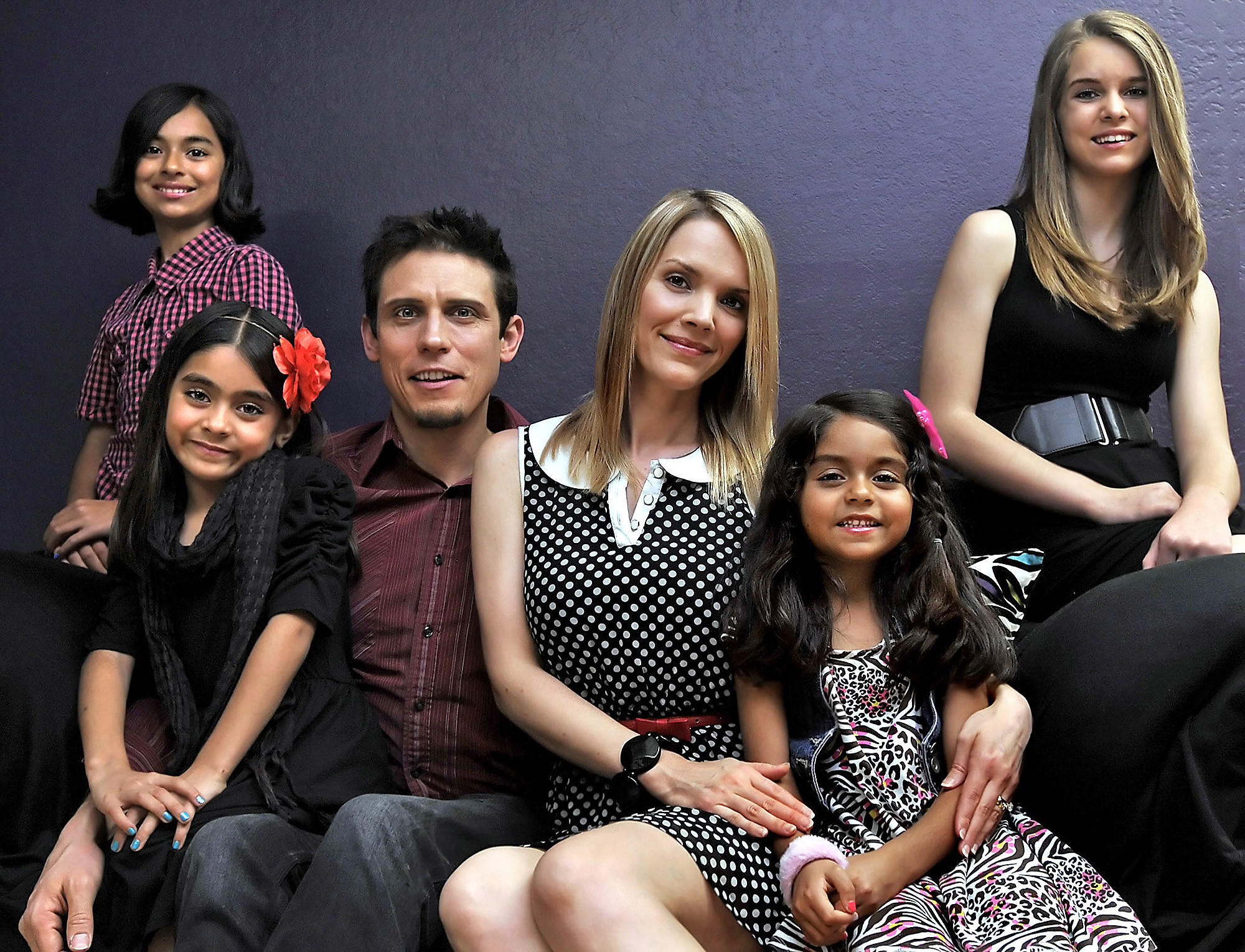 Glendale Community College instructor Ryun Hovind and his wife MeLisa with their adopted children, from left to right: Giselle, 10, Mercedes, 7, Evangeline, 5, and Savannah, 14, at home in Burbank, Thursday, February 20, 2014.