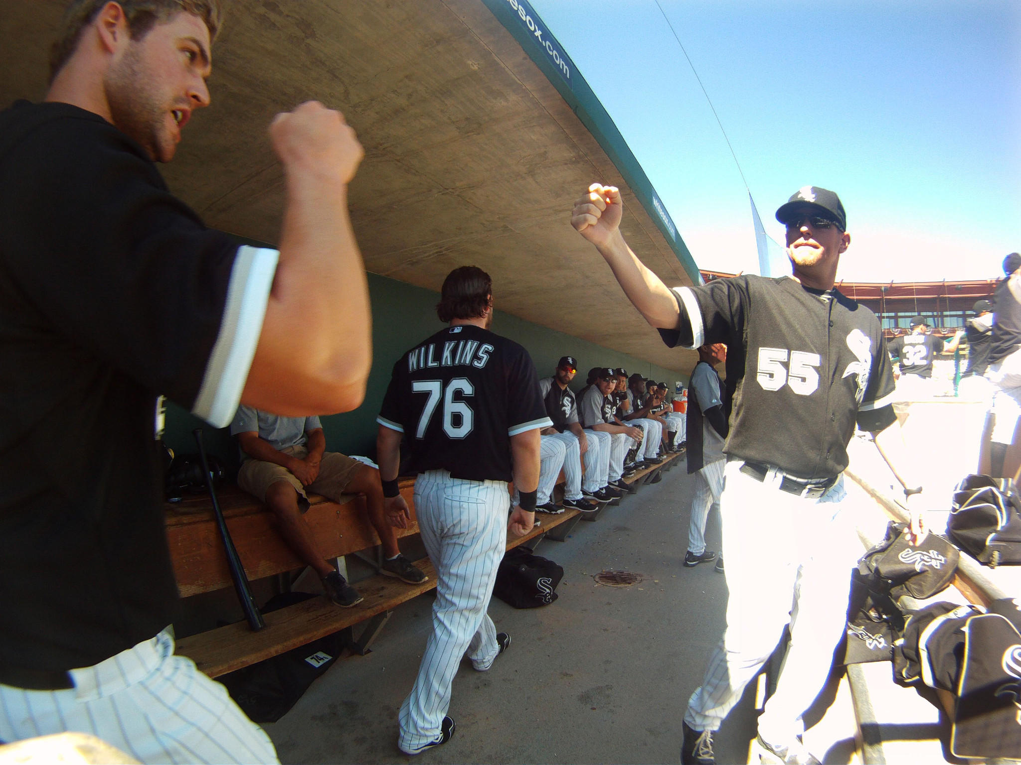 White Sox players Matt Davidson, left, and Felipe Paulino, right fist bum in the dugout Monday, March 3, 2014 during a White Sox win over the Kansas City Royals at spring training in Glendale, Arizona.