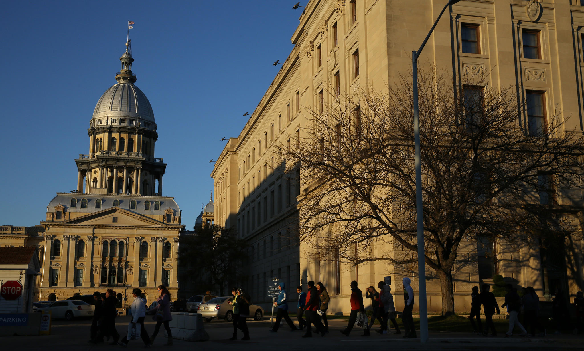 The Illinois State Capitol building glows under the setting sun in Springfield, on Nov. 7, 2013.