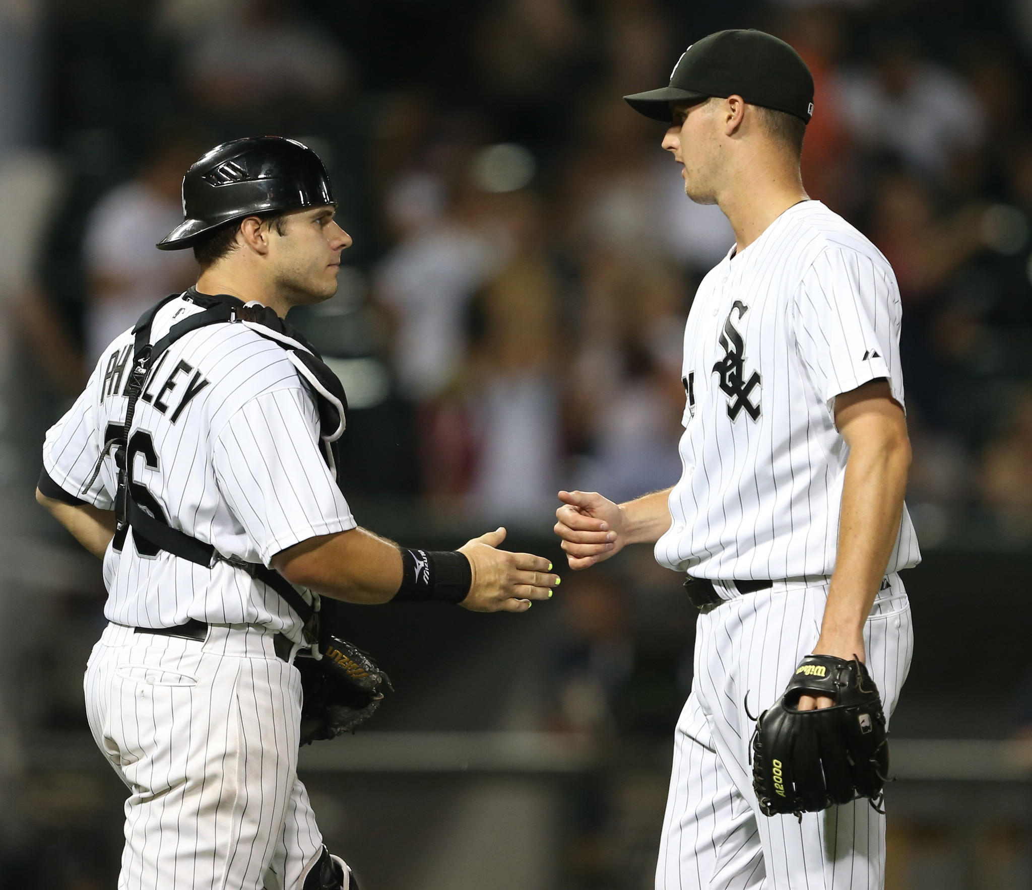 Chicago White Sox catcher Josh Phegley (36), with Chicago White Sox relief pitcher Nate Jones (65), at the end of their team's win over the Detroit Tigers at U.S. Cellular Field, in Chicago, on Monday Sept., 9, 2013.