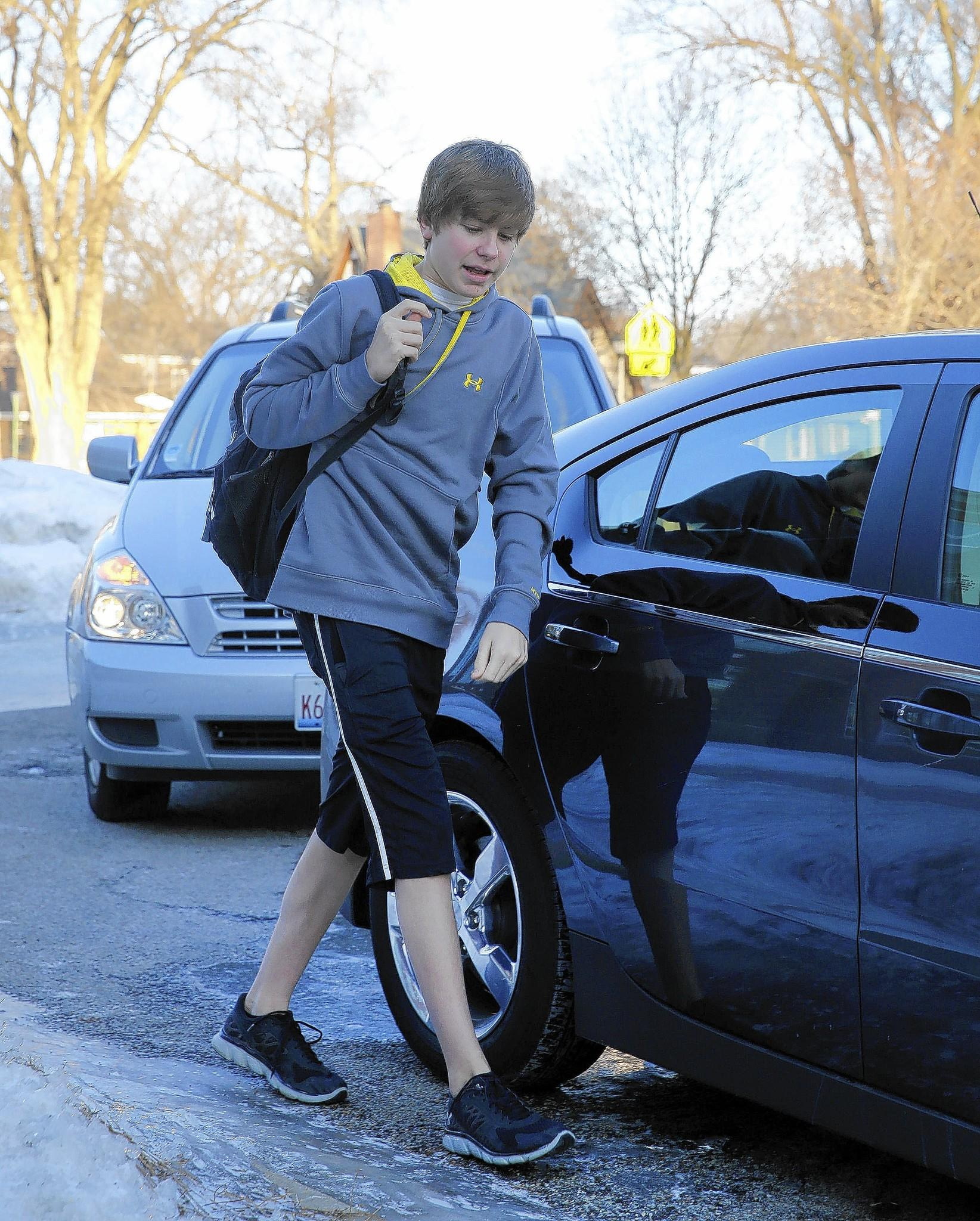 """York Community High School freshman Evan Haug shrugs off a recent 7-degree chill, clad as usual in shorts. """"It's nice and warm in the school, so there's no reason to wear jeans,"""" Evan said."""