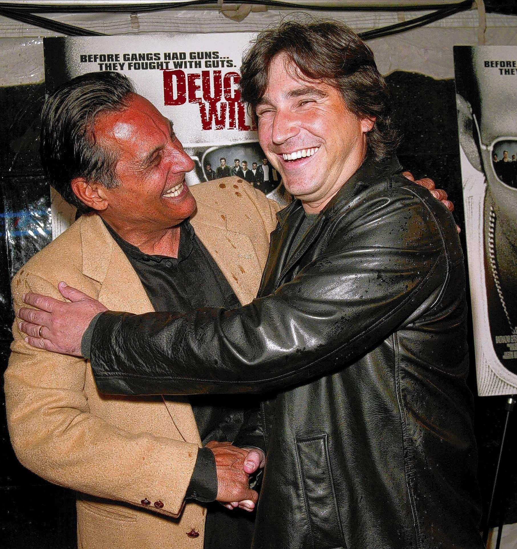 "Writer Paul Kimatian, left, with director Scott Kalvert at the premiere of ""Deuces Wild"" in New York City in 2002. Kalvert, who directed several successful music videos as well as the hit film ""The Basketball Diaries,"" has died at the age of 49."