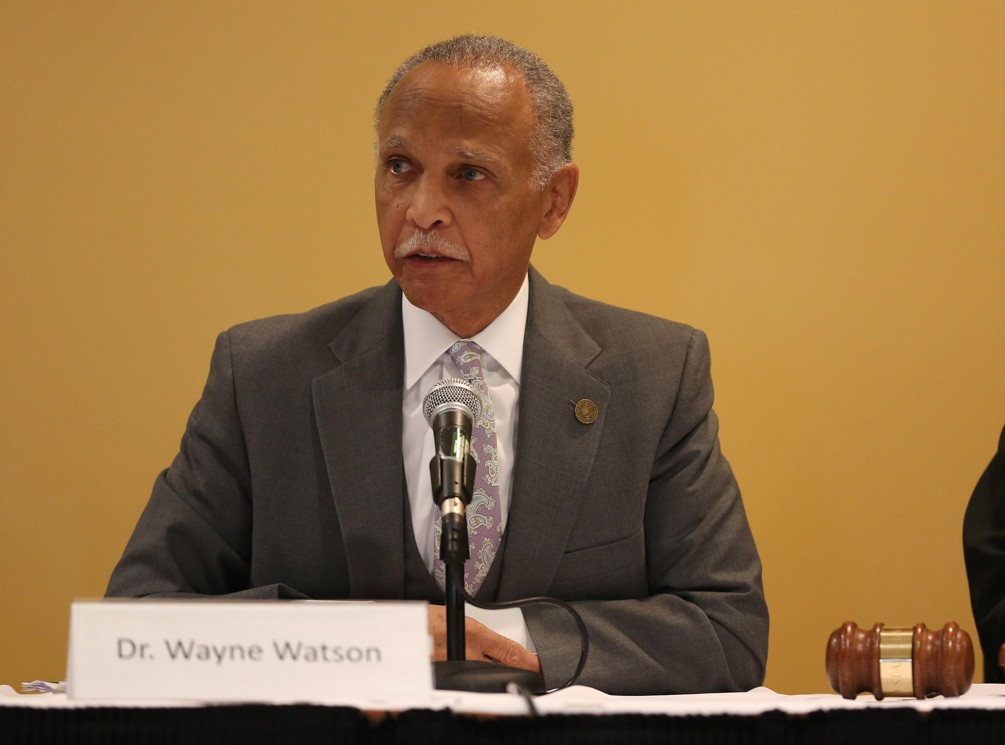 Dr. Wayne Watson, president of Chicago State University, addresses the public concerning his decrease salary as president, during a school board meeting Friday.