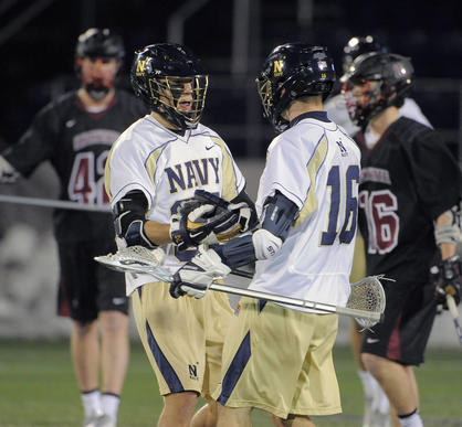 Navy's Tucker Hull, left, celebrates his goal with Jack Hinderland.