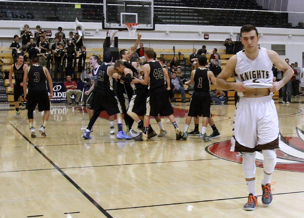 St. Francis High's Markar Agakanian walks off the court after the Golden Knights' 60-53 loss in the CIF Southern Section Division III-A basketball championship game versus Oak Park High at Azusa Pacific University's Felix Event Center on Friday. (Raul Roa/Staff Photographer)