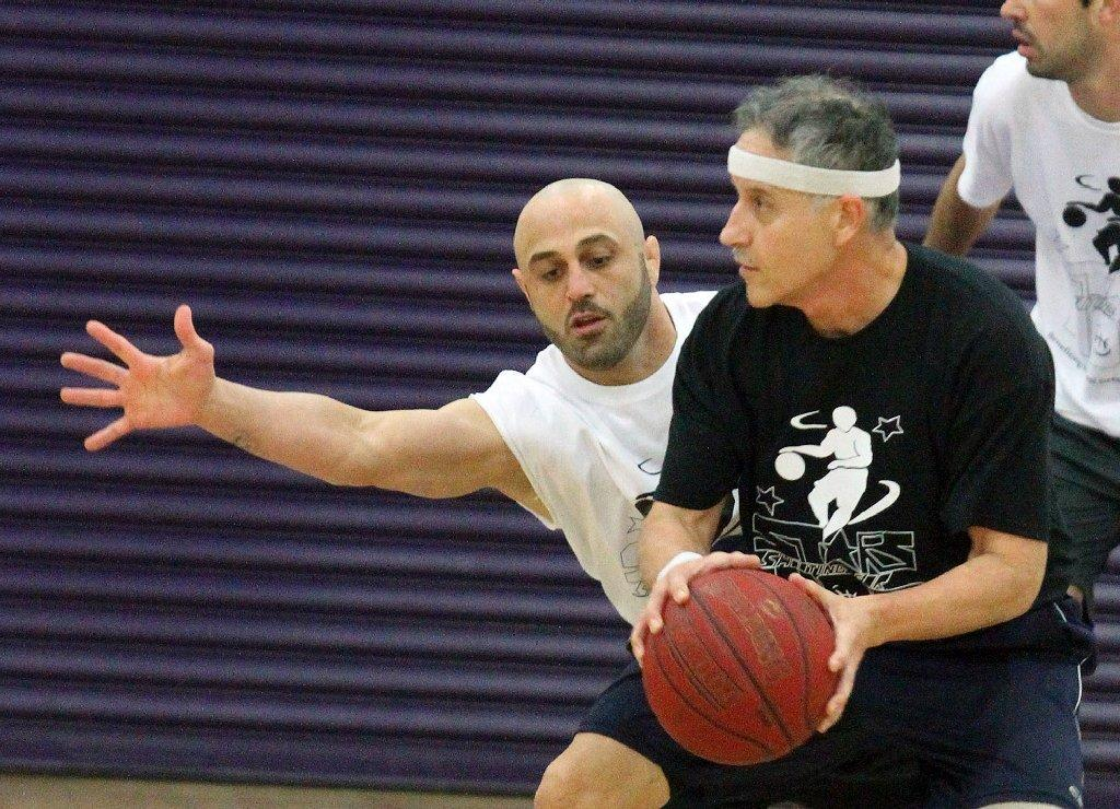 UFC fighter Manny Gamburyan defends against Hoover's Chuck Saint at the Stars Shooting for Hope celebrity basketball game at Hoover High on Friday. The game, which has been played for six years, has raised over $10,000 for the Desi Geetsman Foundation. (Tim Berger/Staff Photographer)