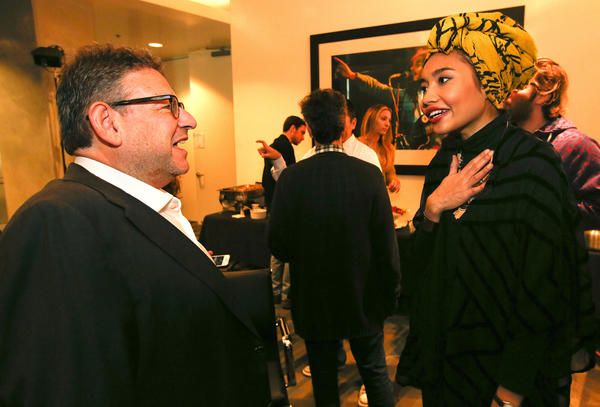 Lucian Grainge, chairman of Universal Music Group, greets Yuna, a 27-year-old pop singer from Malaysia, after she performed for a group of executives at the record company's Santa Monica headquarters in November.