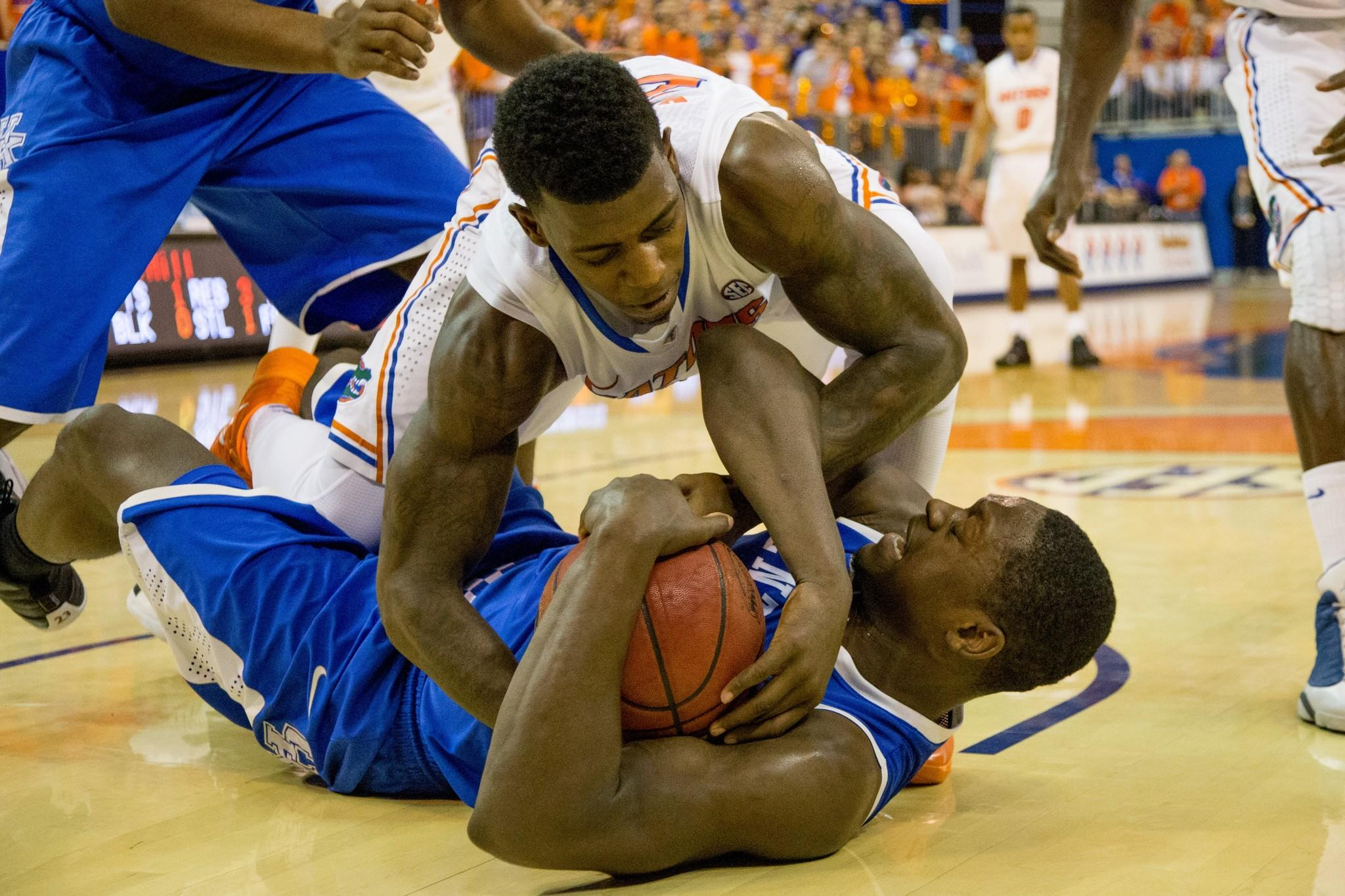 Casey Prather of the Florida Gators and Julius Randle of the Kentucky Wildcats struggle over a loose ball during the first half.