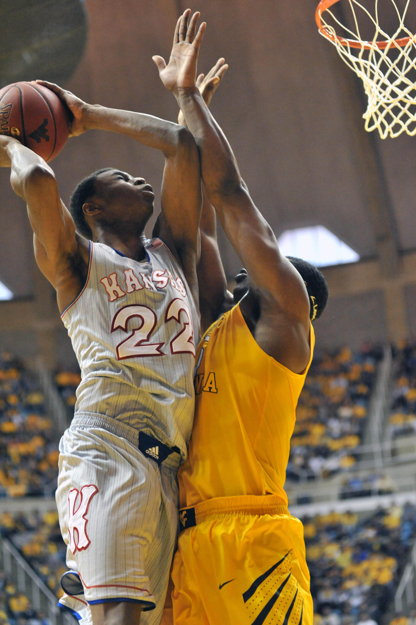 Kansas guard Andrew Wiggins shoots over West Virginia's Devin Williams.