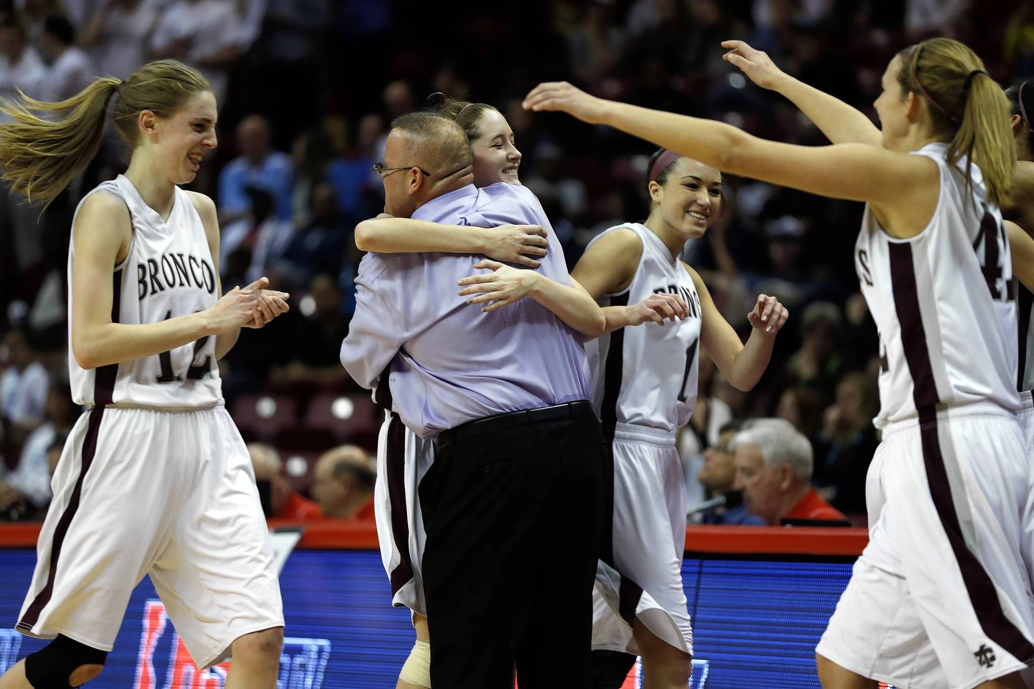 Montini's Kateri Stone hugs head coach Jason Nichols in the final minutes of their 57-44 win.