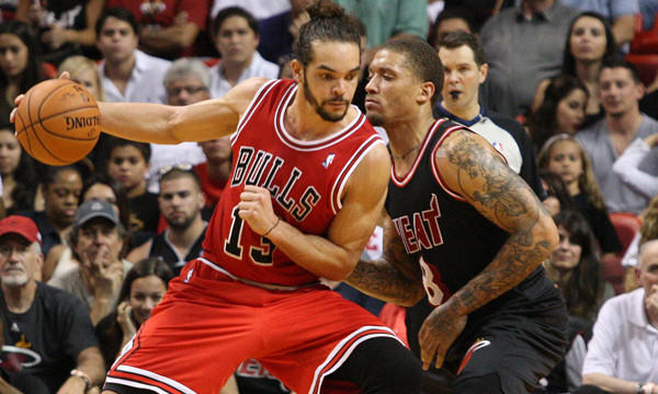 Chicago Bulls center Joakim Noah, left, tries to work the ball past Miami Heat forward Michael Beasley during the Heat's 93-79 win Feb. 23.