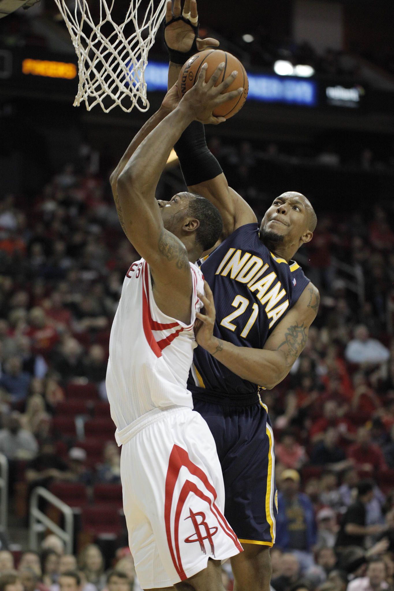 Indiana Pacers power forward David West (21) blocks the shot of Houston Rockets power forward Terrence Jones (6) during the third quarter at Toyota Center.