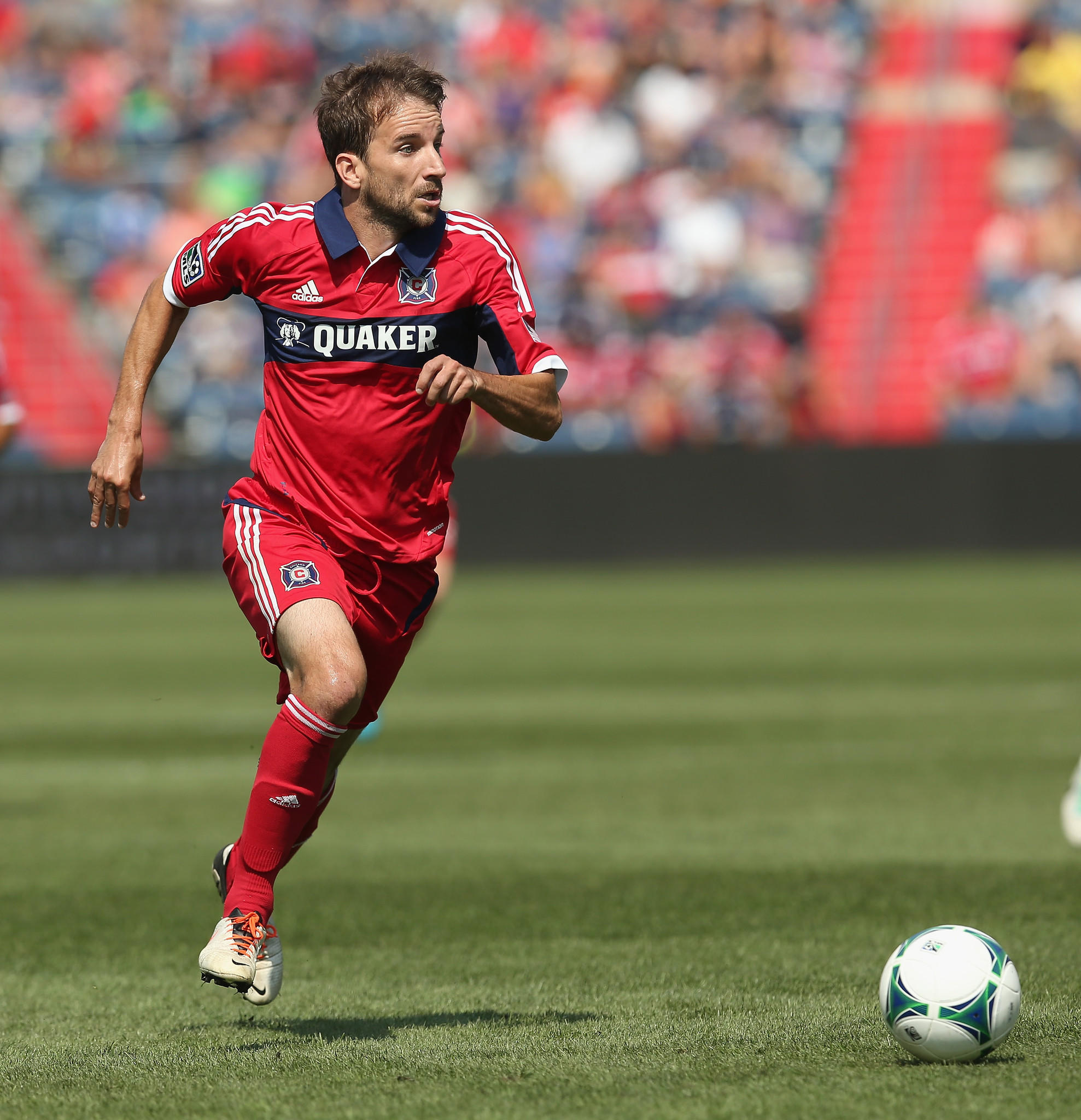 Mike Magee (9) of the Chicago Fire moves a against the Houston Dynamo during an MLS match at Toyota Park on September 1, 2013 in Bridgeview, Illinois. The Fire and the Dynamo tied 1-1.