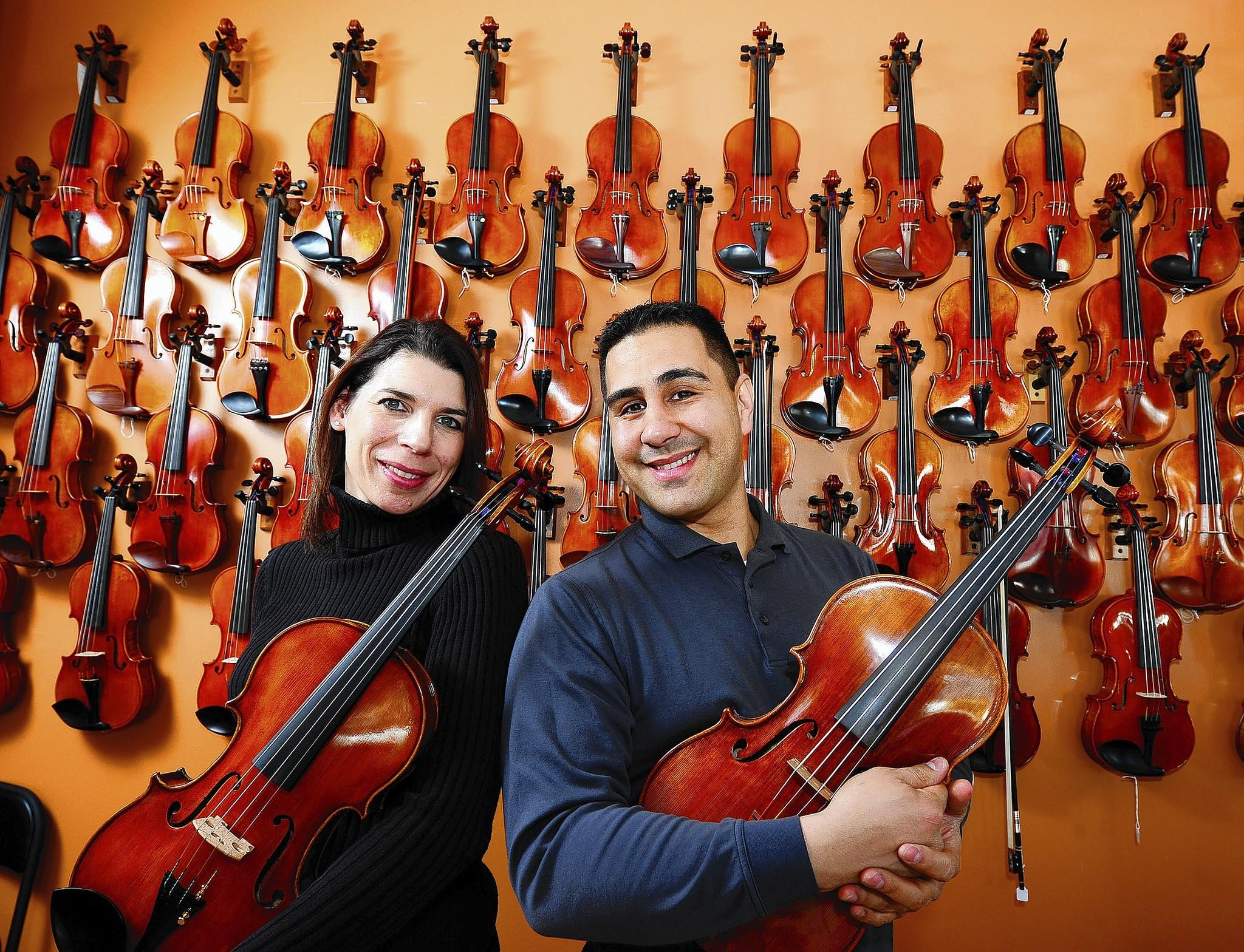 Jen and Mike Montero in their Emmaus violin shop. The Monteros will have a show of their violins, violas, cellos and other musical equipment at the Hotel Bethlehem.