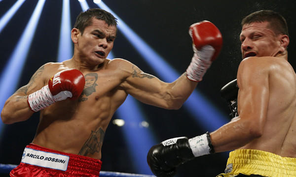 Marcos Maidana, left, punches Jesus Soto Karass during their welterweight fight in Las Vegas in September 2012. Maidana went on to win the bout.