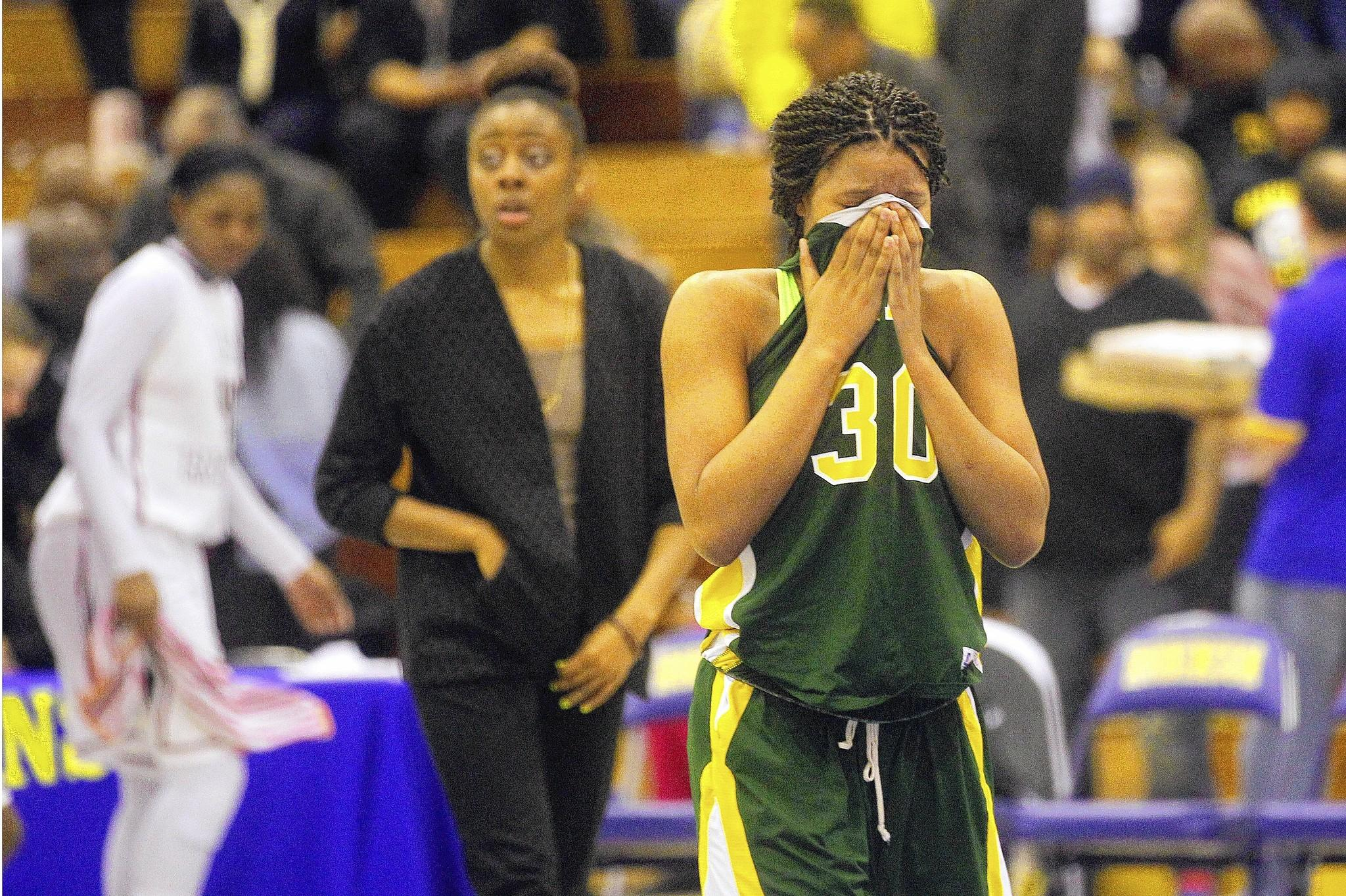 Behtel's Britani Bryson, right, cries after losing to Stonewall Jackson during Saturday's Group 6A state semifinal game at Robinson High School in Fairfax.