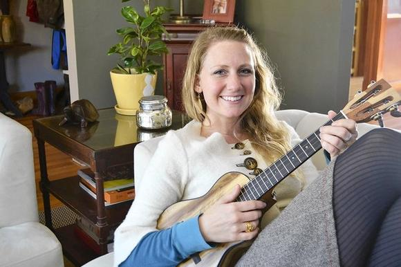 Victoria Vox at home with one of her many instruments