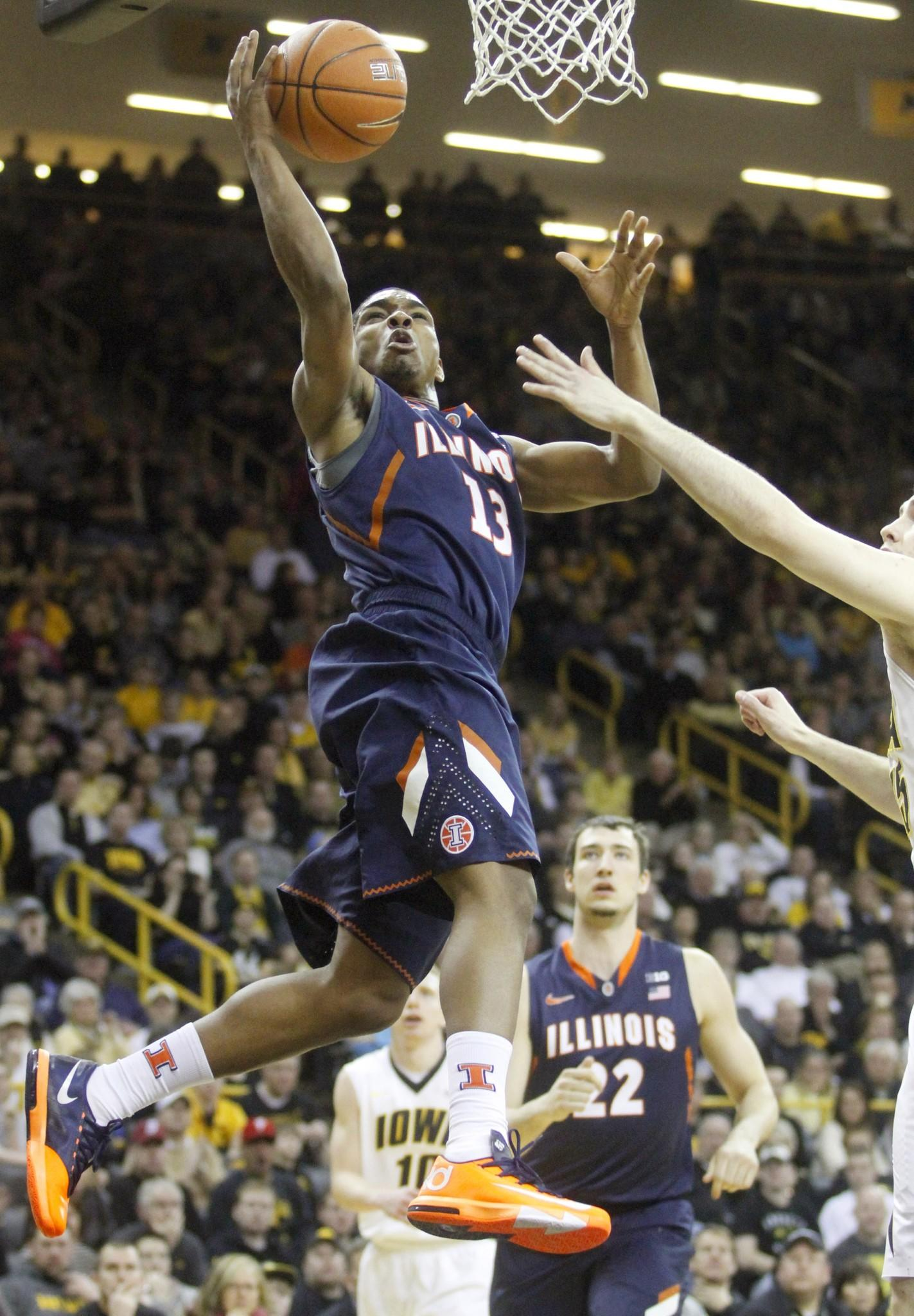 Guard Tracy Abrams (13) of the Illinois Fighting Illini goes to the basket during the first half against Iowa on March 8, 2014 at Carver-Hawkeye Arena, in Iowa City, Iowa.