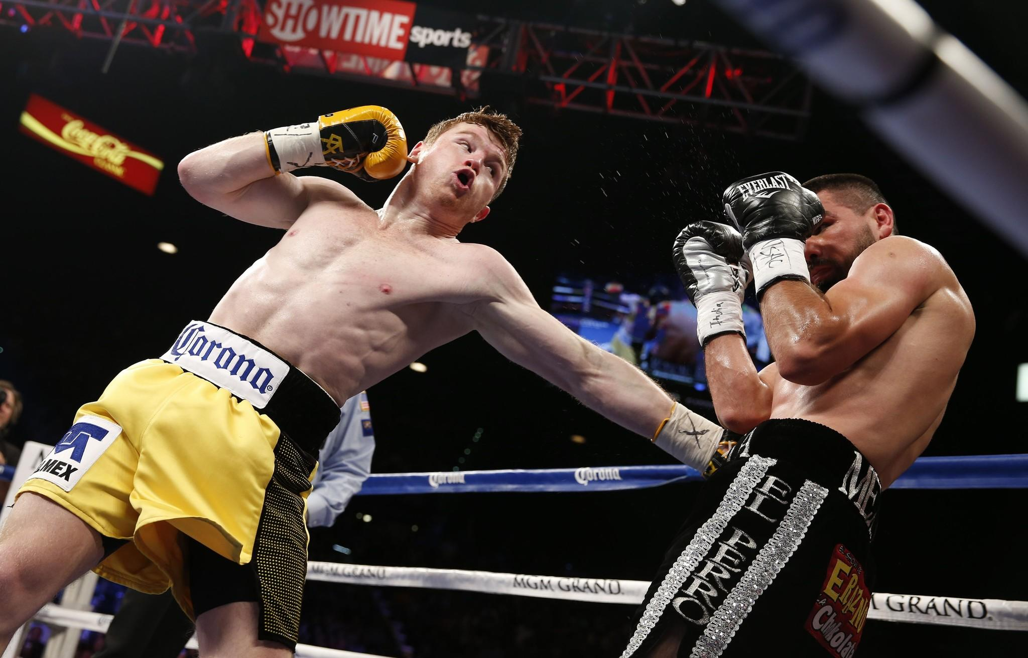 "Saul ""Canelo"" Alvarez, left, defeated Alfredo Angulo by TKO in the 10th round Saturday night in Las Vegas."