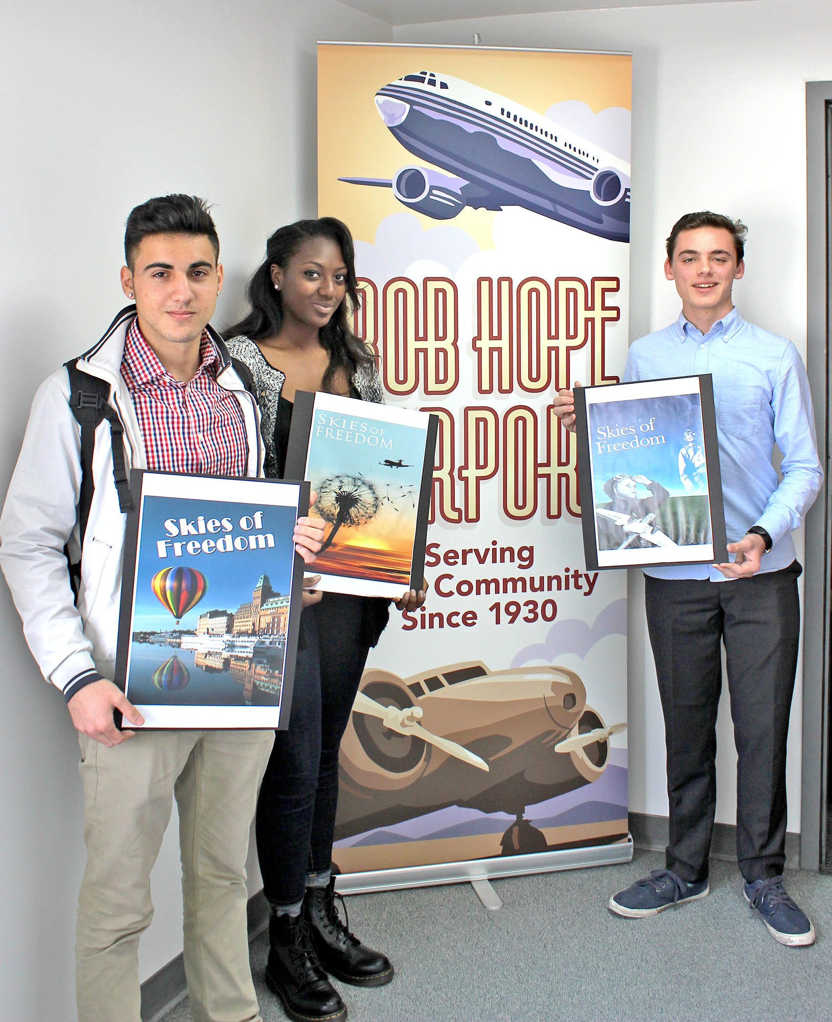 Burbank winners of the Bob Hope Airport 2014 Tower Banner Student Art Contest are, from left, Burbank High School juniors Elias Shankaji and Naija Erby and freshman Angus Crosby.